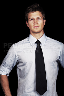 Buy stock photo Confident Male ModelA trendy European businessman with a blue tie and shirt. Isolated studio picture on black background. This series is of a professional Danish Model.