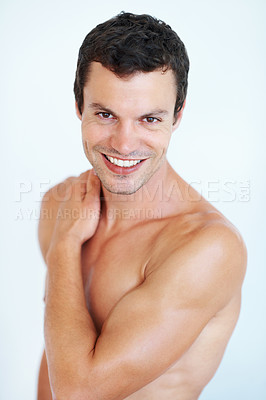 Buy stock photo Portrait of smiling handsome man with hand on his shoulder