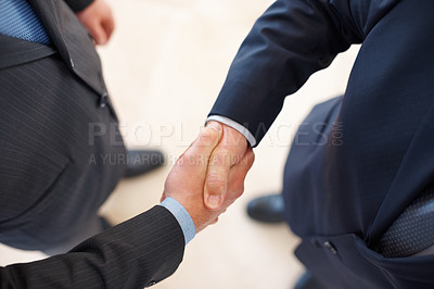 Buy stock photo Two businesspeople shaking hands