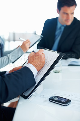 Buy stock photo Portrait of business people taking notes during meeting in office