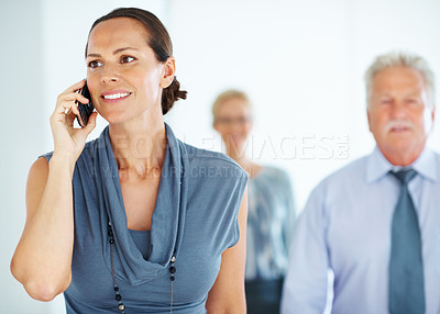 Buy stock photo Portrait of smiling pretty business woman talking on cellphone with colleagues
