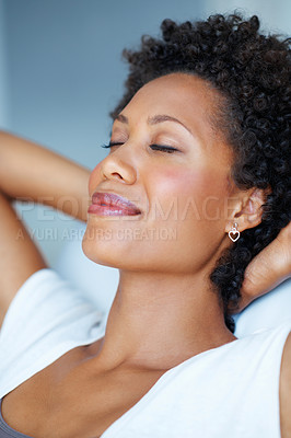 Buy stock photo Closeup of pretty African American woman relaxing with hands behind head