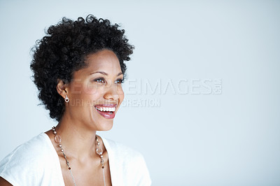 Buy stock photo Closeup of charming African American woman smiling while looking at copyspace