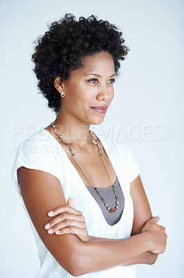 Buy stock photo Smiling African American woman looking away with hands folded