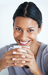 Cheerful woman having coffee