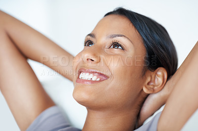 Buy stock photo Closeup of beautiful mixed race woman relaxing on couch, looking away