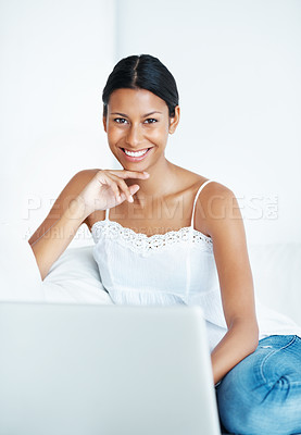 Buy stock photo Portrait of smiling mixed race woman relaxing at home with laptop