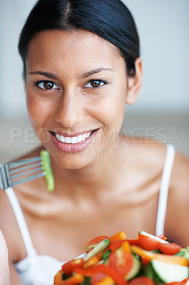 Buy stock photo Portrait of attractive mixed race woman with bowl fresh vegetable salad