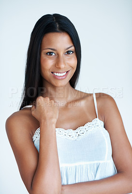 Buy stock photo Portrait of attractive mixed race woman smiling on plain background