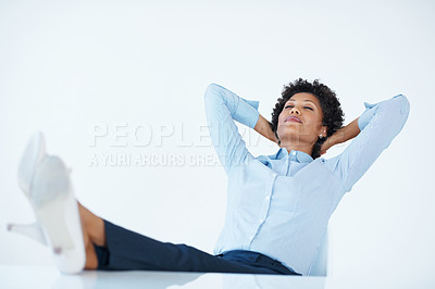 Buy stock photo African American female executive relaxing at work with legs on desk