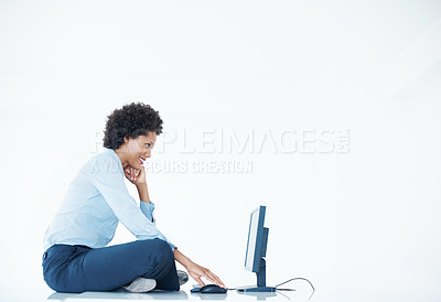 Buy stock photo Confident business woman sitting on desk using computer - copyspace