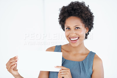 Buy stock photo Confident African American woman smiling while showing blank card on white background