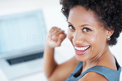 Buy stock photo Closeup of successful female executive smiling while working on laptop
