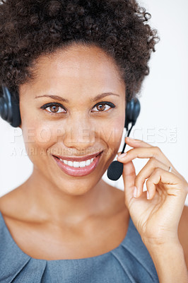 Buy stock photo Portrait of confident female customer service representative with headset smiling
