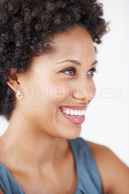 Buy stock photo Closeup of thoughtful African American woman smiling while looking away