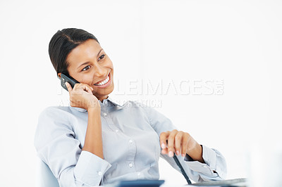 Buy stock photo Beautiful mixed race business woman talking on mobile phone