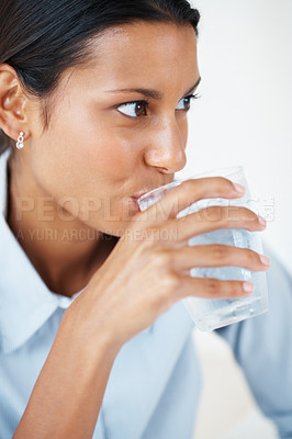 Buy stock photo Closeup of young business woman drinking water
