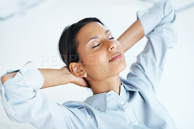 Buy stock photo High angle view of mixed race female executive relaxing at workplace with eyes closed