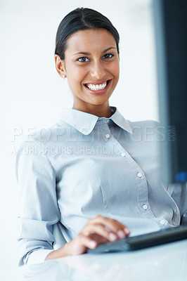 Buy stock photo Portrait of mixed race female executive smiling while using computer