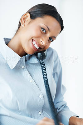 Buy stock photo Portrait of mixed race female executive smiling using phone