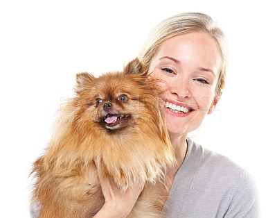 Buy stock photo Closeup of a smiling blonde holding her pomeranian dog
