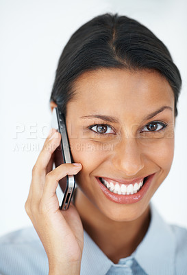 Buy stock photo Closeup portrait of attractive female executive smiling while talking on mobile phone