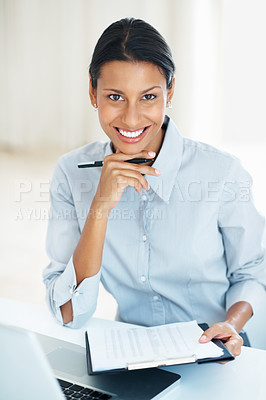 Buy stock photo Portrait of smiling mixed race business woman checking documents at office desk