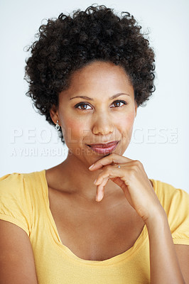 Buy stock photo Portrait of confident African American woman smiling with hand on chin