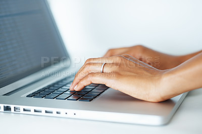 Buy stock photo Closeup of woman's hand typing on laptop keypad
