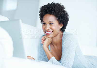 Buy stock photo Lovely African American woman smiling using laptop on couch
