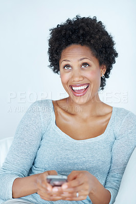 Buy stock photo Excited young woman reading text message on mobile phone