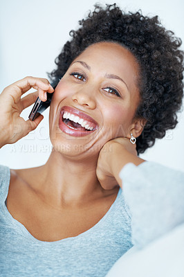 Buy stock photo Closeup of African American woman laughing during talking to friend on cellphone