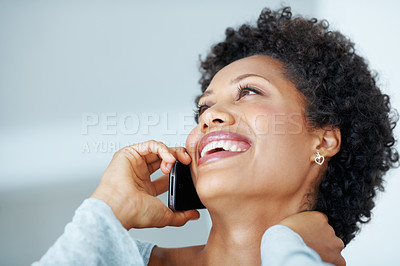 Buy stock photo Closeup of attractive African American woman smiling during phone call