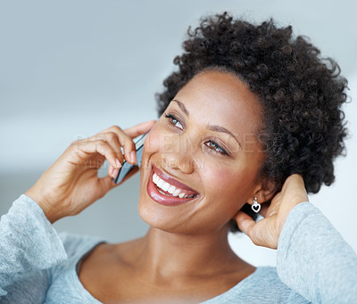 Buy stock photo Gorgeous African American woman smiling while talking on cellphone
