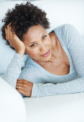 Buy stock photo Portrait of charming young woman smiling while resting on couch