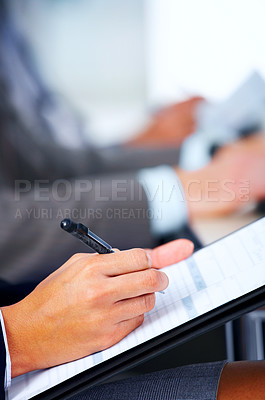 Buy stock photo Line of people taking notes at a college lecture, conference or meeting