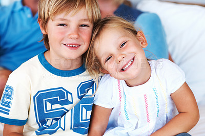 Buy stock photo Portrait of cute boy smiling with little sister , parents in background