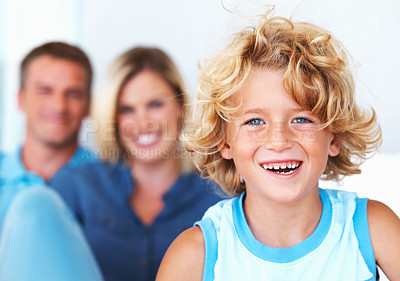 Buy stock photo Closeup of cute little boy smiling with parents in background