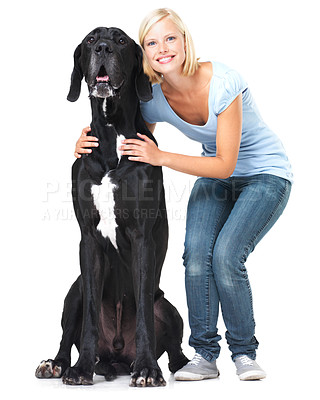 Buy stock photo Cute young woman standing alongside her great dane with a smile - isolated on white