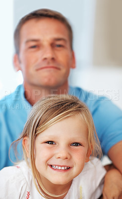 Buy stock photo Adorable little girl smiling at home with father in background