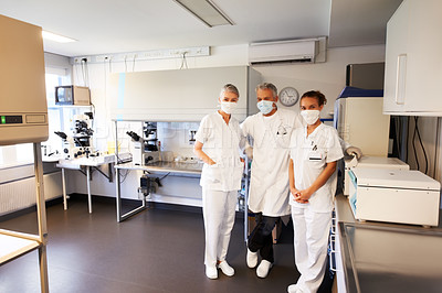 Buy stock photo Successful team of scientist standing together at hitech laboratory