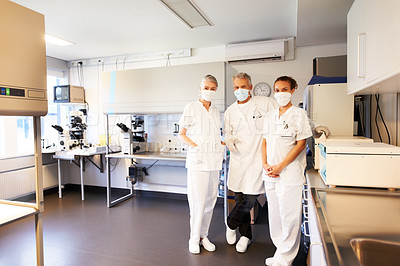 Buy stock photo Three medical scientist standing in scientific research center