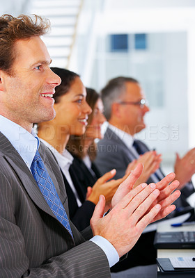 Buy stock photo Congratulations - business team at a conference congratulating a guest speaker