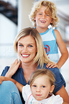 Buy stock photo Portrait of beautiful woman smiling with son and daughter at home