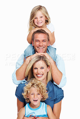 Buy stock photo A family of four standing one behind the other with hands on each others heads - isolated on white