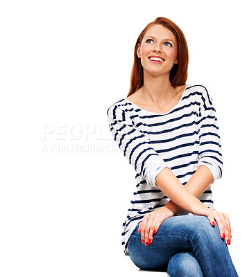 Buy stock photo An attractive redhead sitting and smiling while looking up and isolated on a white background