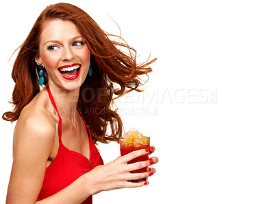 Buy stock photo A young redhead holding a refreshing glass of cooldrink while isolated on white