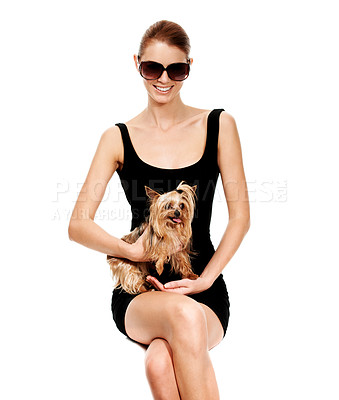 Buy stock photo Portrait of an attactive young woman holding her pet yorkie on her lap