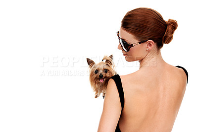 Buy stock photo Rearview of an attractive young redhead holding her yorkshire terrier