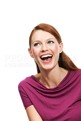 Buy stock photo An attractive young woman looking away and laughing